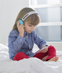 young child with headphones on
