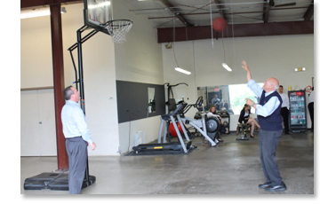 Ken Blanchard playing basketball with EarQ president Ed Keller